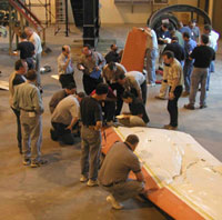 Practical training at the NTSB - Students looking at airplane wreckage.