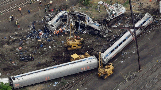 Figure 2. Two passenger cars on their side and the remains of a damaged passenger car