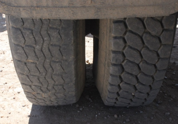 Photo of the tire tread on the right rear tires from the 2004 Kenworth International agricultural truck.