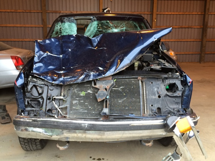 Figure 2. Front view of the pickup truck, showing damage from impacts. (Note that some of the damage resulted from two previous