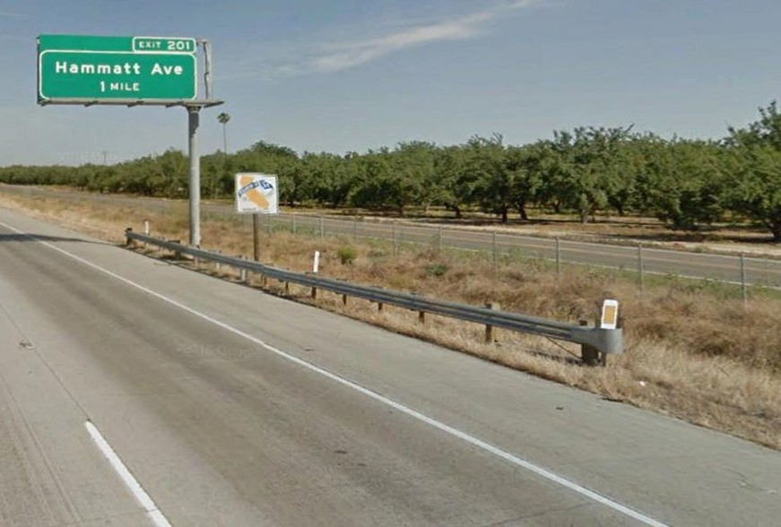 Figure 2. Northbound view of the sign, signpost, and guardrail (Source: Google Maps, July 2016).