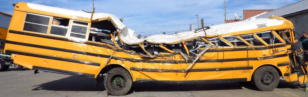 Figure 1. Right side view of school bus showing impact damage.