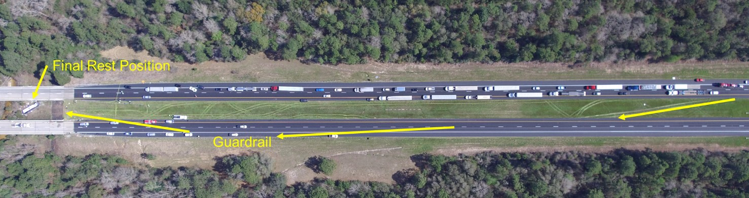 Overhead photo of scene postcrash, showing path and final rest position of motorcoach (yellow arrows).
