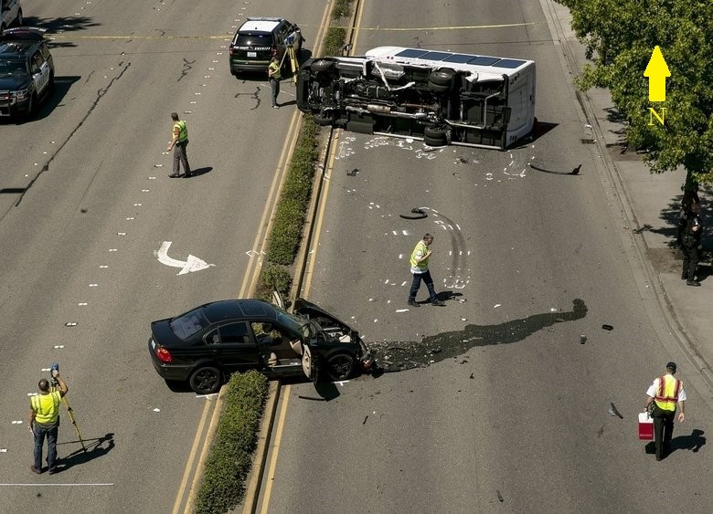 The final rest positions of the transit shuttle bus and passenger vehicle involved in the crash on International Blvd.