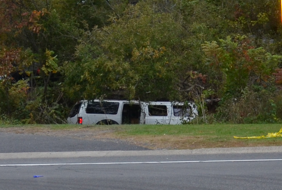 Photo of crash-involved 2001 Ford Excursion stretch limousine at final rest in the ravine.