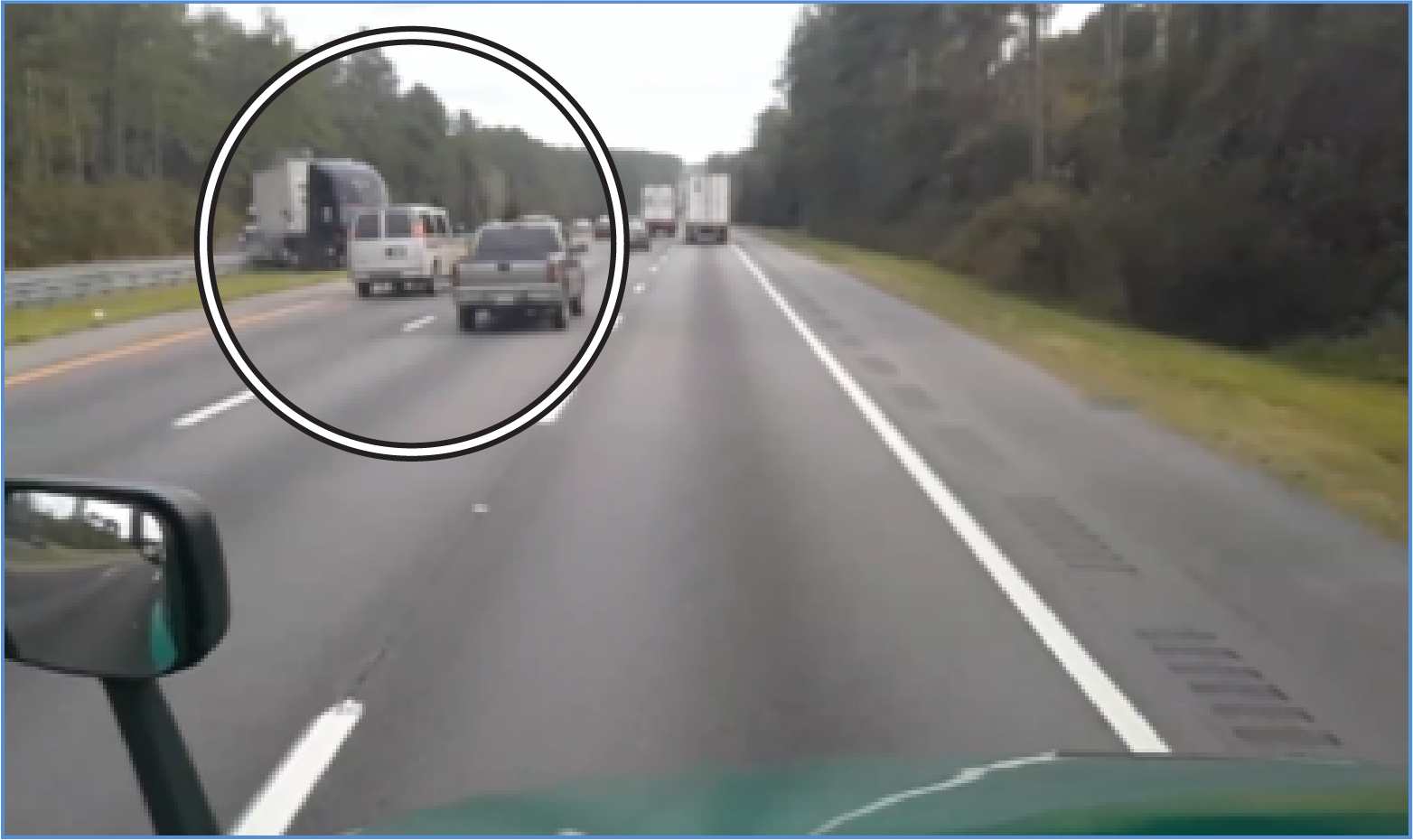 Screen shot from Garmin forward-facing video camera, showing the 2016 Freightliner entering southbound lanes, at upper left.