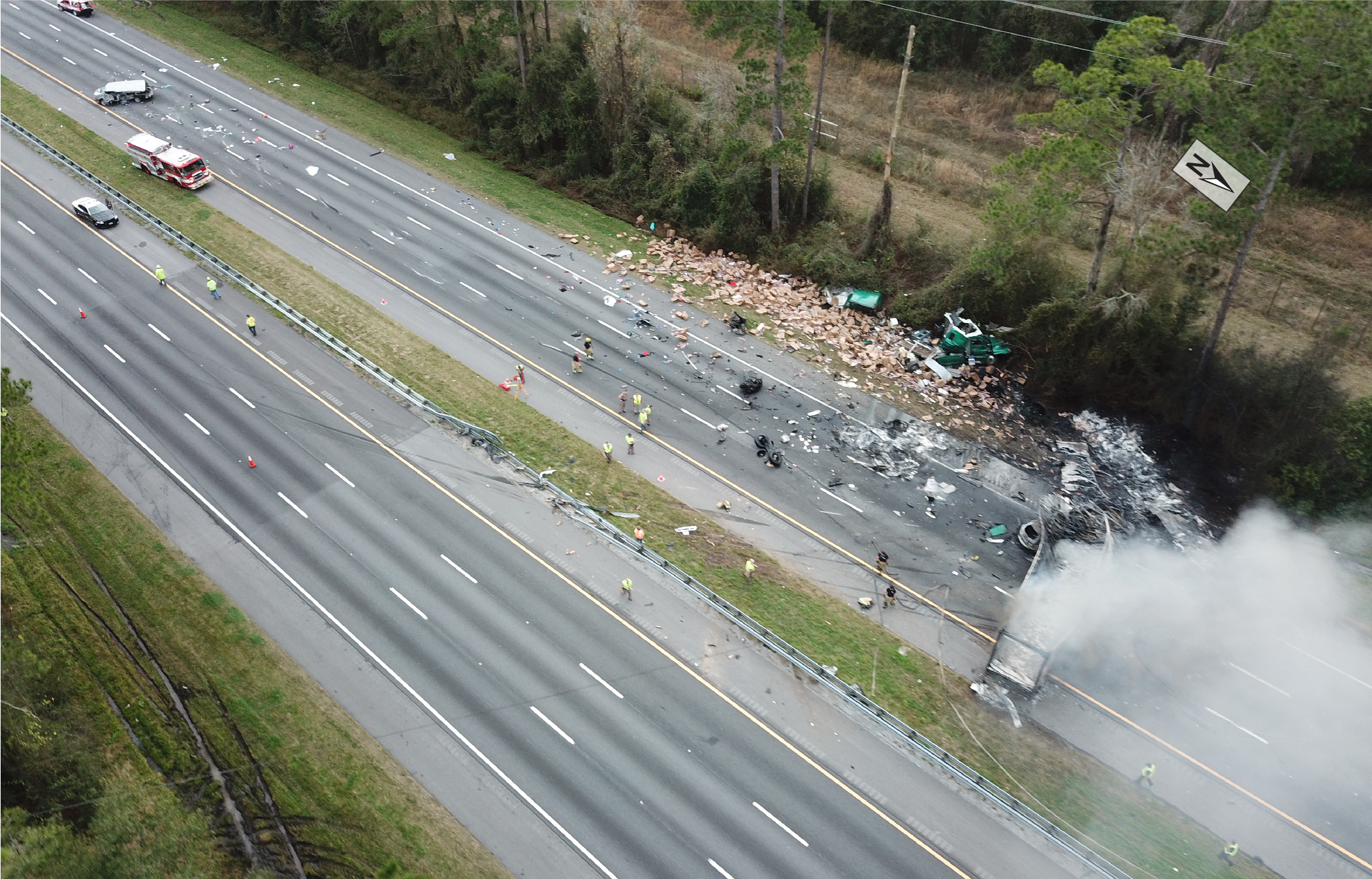 Aerial view of crash scene with vehicles at final rest.