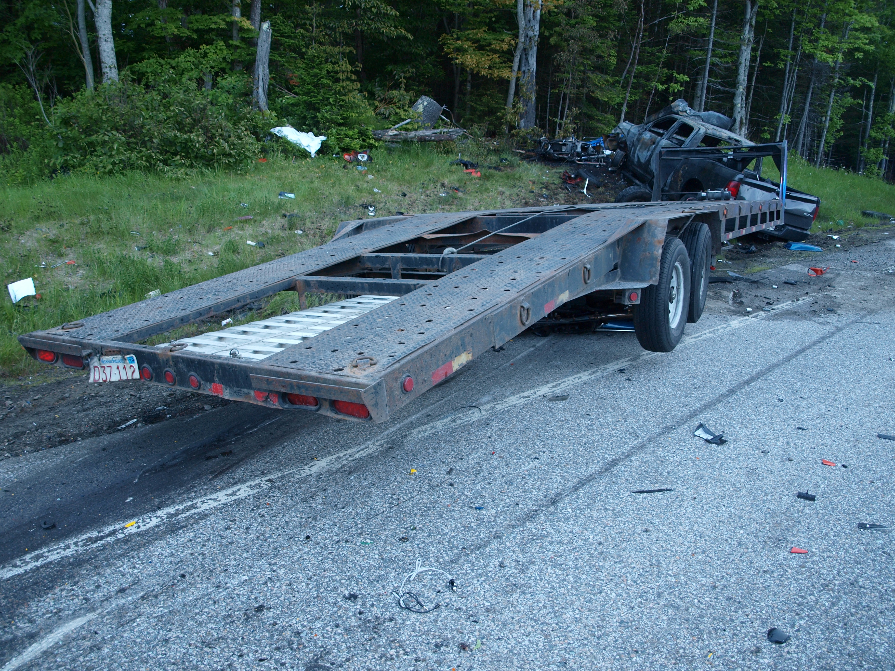 Pickup truck and trailer at final rest on eastbound shoulder of Gorham Hill Road. (Source: New Hampshire State Police).