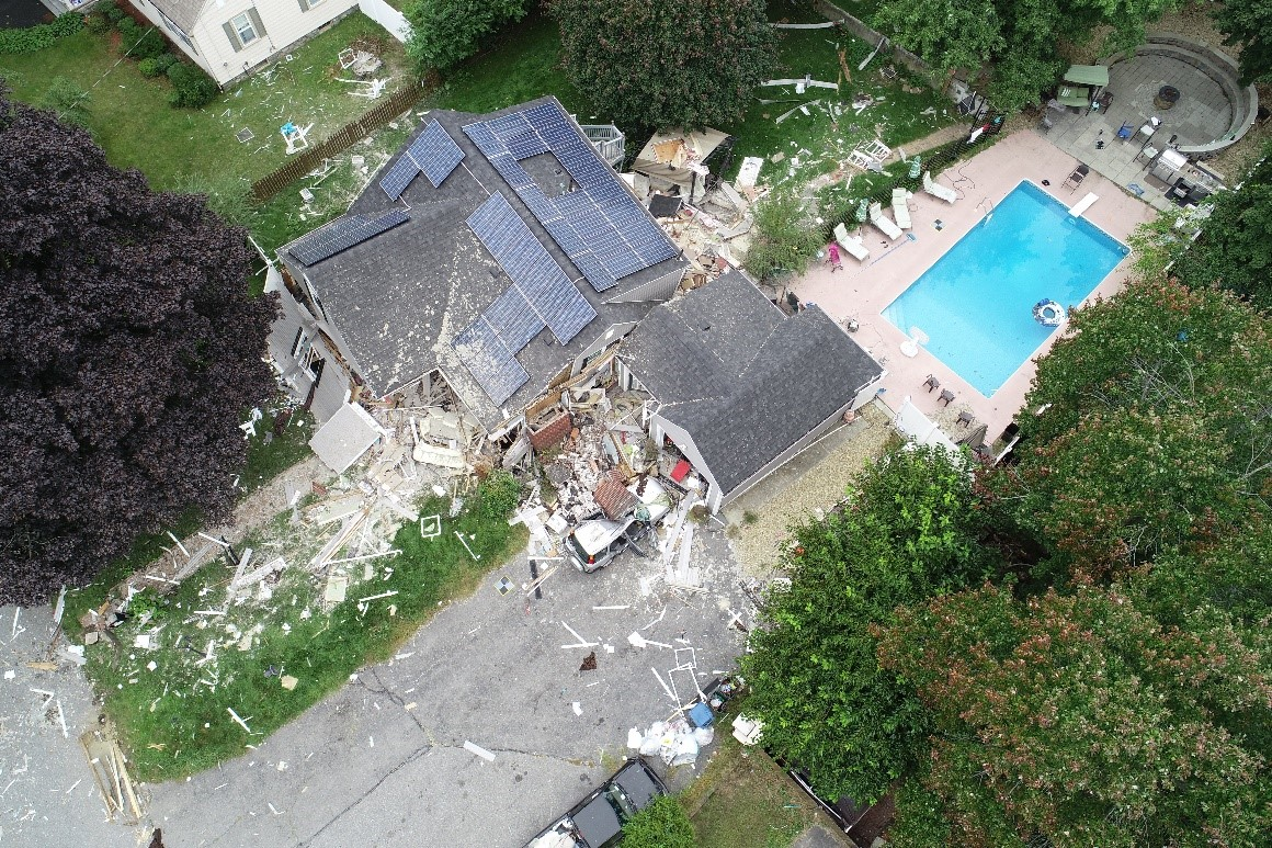 Aerial view of damaged home where a fatality occurred after the chimney collapsed.