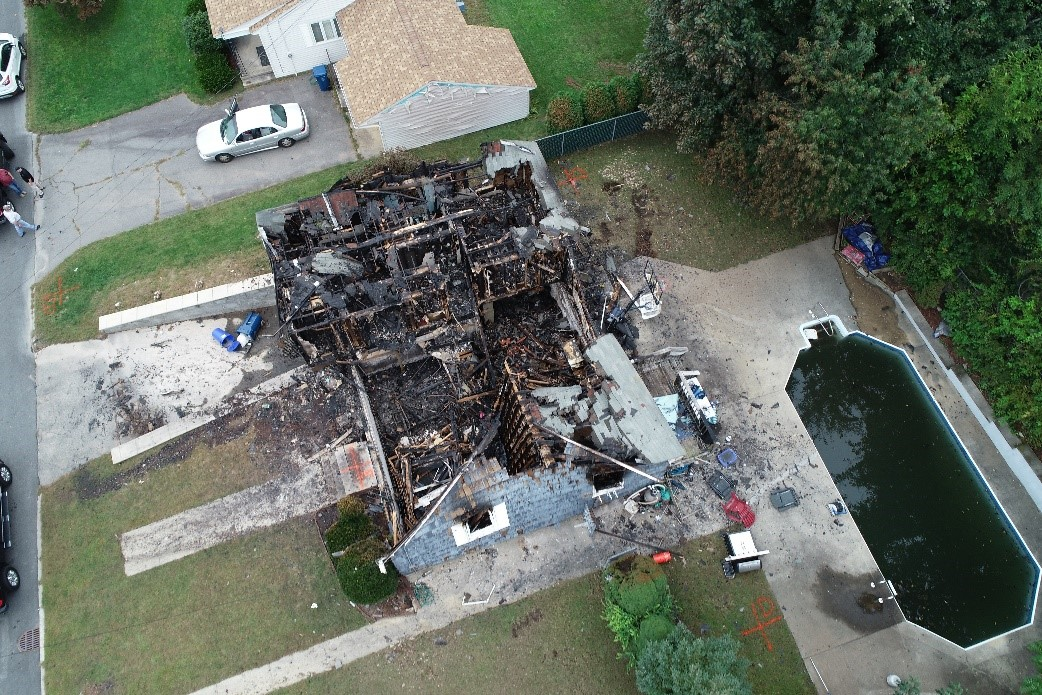 Aerial view of burned-out home impacted by the event.