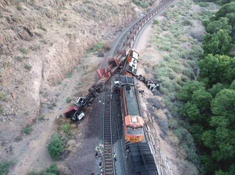 This photograph is an aerial view showing the two trains that collided. The trains are on a right-hand curve. The lead locomotiv