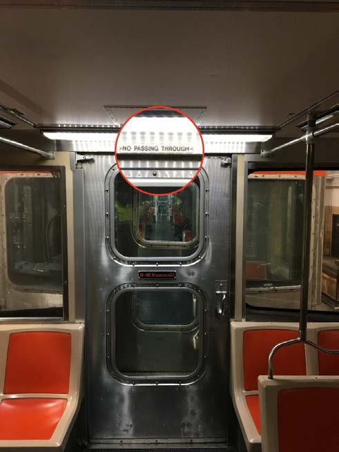 Photograph of a SEPTA subway end-of-car door warning sign.