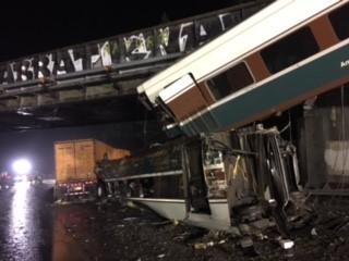 figure 2 derailed passenger railcars on interstate 5