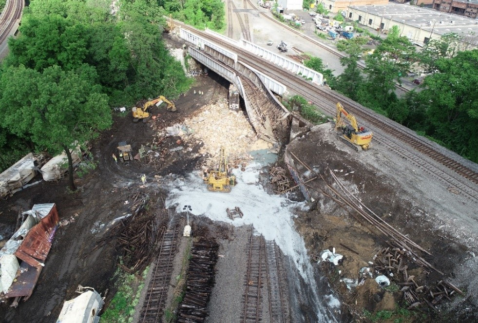 NTSB drone aerial photograph of damaged bridge and debris.