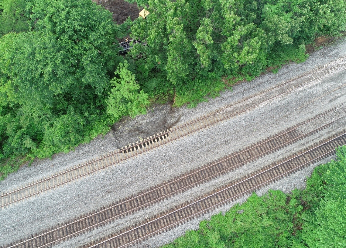 NTSB aerial drone photograph taken after freight cars were removed from main track one.