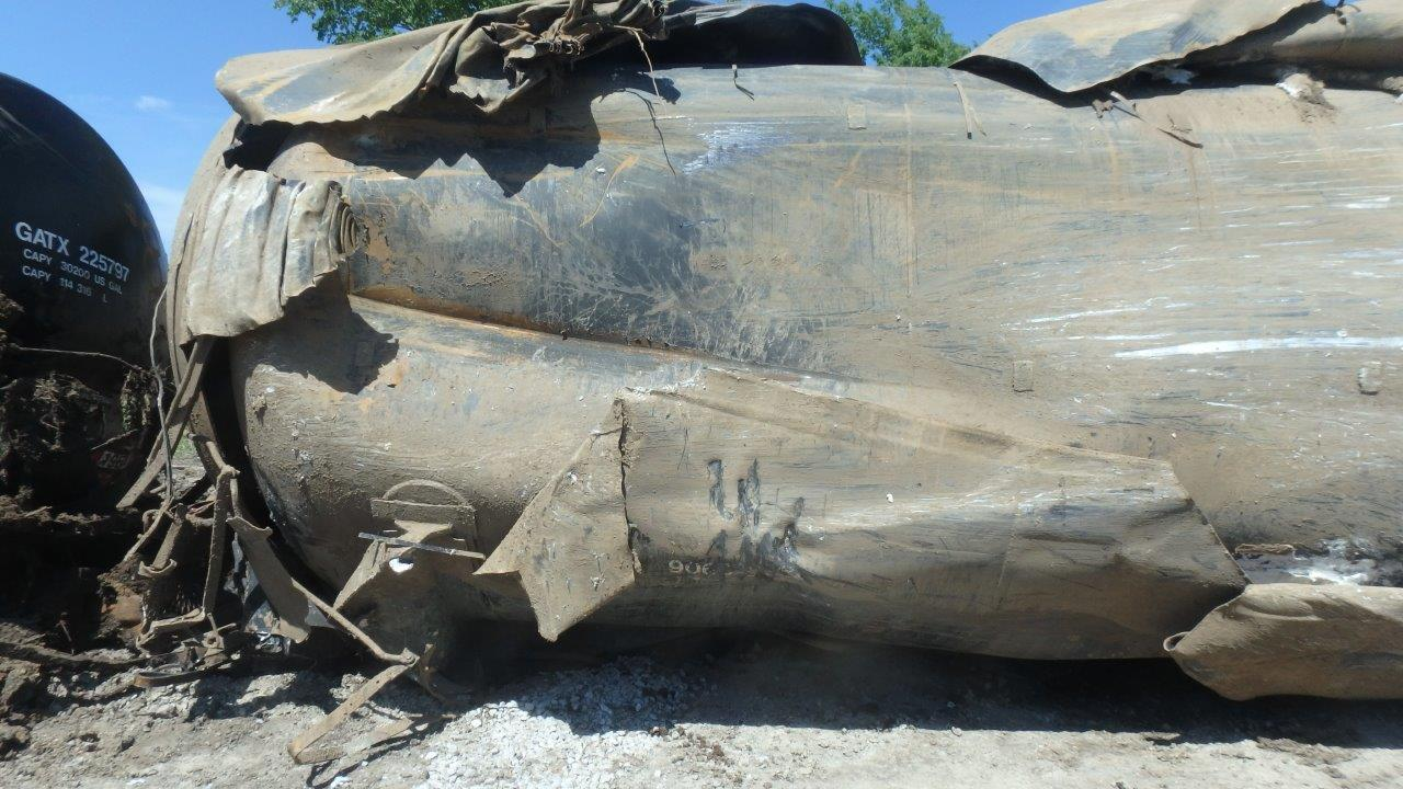 Photo of DOT-117J100W tank car, which sustained impact damage, but did not release denatured ethanol.