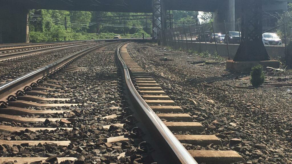 Photo of the track showing the misalignment looking west toward catenary bridge 215.