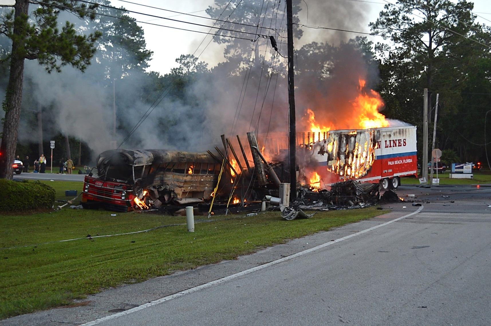 Bus and truck involved in the St. Marks, Florida, crash on fire in their final rest positions on the southwest corner of the int