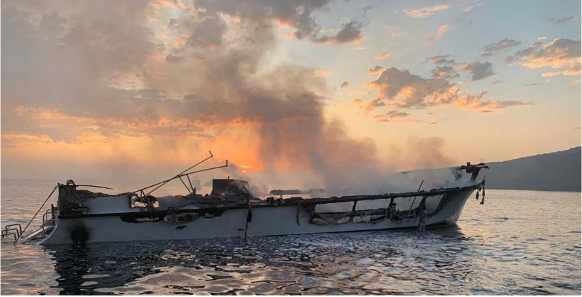 Photo of Conception's burned hull at dawn on Sept. 2, 2019, prior to sinking.